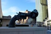 Non-Violence knotted gun firearm sculpture peace liberal foreign policy Wikimedia Commons